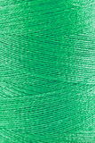 Green thread in spool Stock Photography