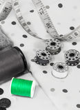 Green thread spool , Sewing utensils gray color Royalty Free Stock Image