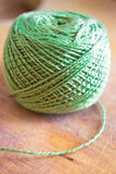 Green thread spool  on wood Stock Images