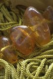 Green threads and amber Royalty Free Stock Image