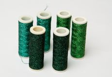 Green threads. Six spools of green threads - various shades of green on white background Stock Image