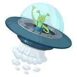 A green three-eyed alien in a flying saucer with a transparent dome holds the control lever and waving his hand in greeting Stock Image