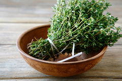 Green thyme in a bowl on boards Royalty Free Stock Images