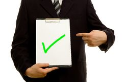 Green tick on clipboard Stock Photos