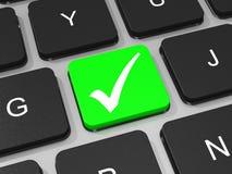 Green tick key on keyboard of laptop computer. Royalty Free Stock Photos