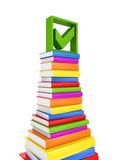Green tick mark on a big stack of colorful books. Royalty Free Stock Photography