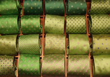 Green ties selection. Rows of colorful fashionable and elegant ties. Man's wear Royalty Free Stock Photo