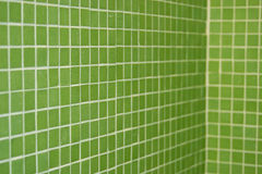 Green tile in perspective. Green tiled walls in perspective with soft focus Royalty Free Stock Photo