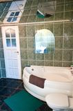 Green tiled bathroom with mirror ceiling royalty free stock photos