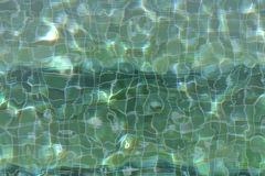 Green tiles under pool water Royalty Free Stock Images