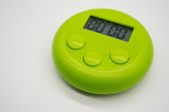 Green timer  on white. Background Royalty Free Stock Images