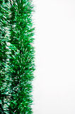 Green tinsel bright garland isolated on white background. Royalty Free Stock Photography
