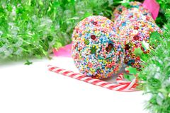Green tinsel with Christmas balls and candy canes Stock Photo