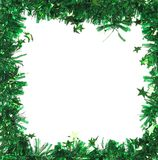 Green tinsel with stars as frame. Stock Photos