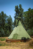 Green Tipi. Single native american tipi tent in a camping park stock photography