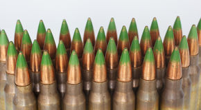 Green tipped ammo on white stock images