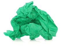 Green Tissue Paper. In a crumpled up ball over white background Royalty Free Stock Photo