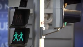 Green to red traffic LED light for pedestrians symbolizing a Gay couple in a street of Madrid. Green to red traffic LED light for pedestrians with 2 man sign stock footage