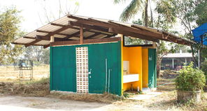 The green toilet with thai building style at local Thailand. A green concrete toilet hut with open doors Stock Images