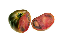 Green tomato. Isolated sliced green tomato in perspective view Stock Photo