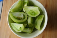 Green tomato salad. Green tomato slices in ceramic bowl Royalty Free Stock Images