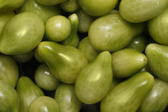 Green tomatoes. Image of home grown green cherry tomatoes Stock Photo