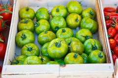 Green tomatoes from mediterranean farmers market in Provence. Organic fresh green tomatoes from mediterranean farmers market. Healthy local food market. Variety Stock Images