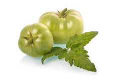 Green tomatoes vegetables with leaves isolated Stock Photo