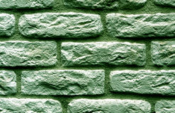 Green toned brick wall surface. Royalty Free Stock Photography