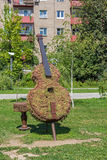 Green topiary statue of bass viol. Green topiary statue of a bass viol Royalty Free Stock Image