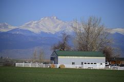Green topped White Barn and Longs Peak Royalty Free Stock Image