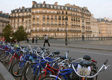 Green tourism in Paris. Eco-tour bicycles parked on a pedestrian bridge in Paris Royalty Free Stock Images