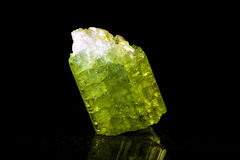 Green tourmaline in front of black Royalty Free Stock Photos