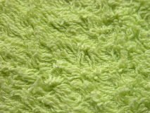 Green towel. Macro of a long threaded hand towel Royalty Free Stock Photo