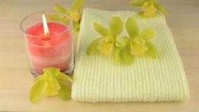 Towel and glass candle