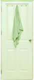 Green towel hang on a wooden door Royalty Free Stock Photo