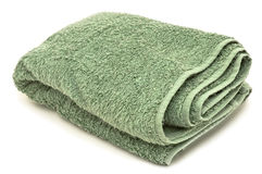 Green towel, isolated on white background stock photography