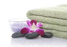 Green Towel, Orchid, Bath Salt and Pebble Royalty Free Stock Image