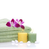 Green Towel, Orchid, Candles and Pebbles Royalty Free Stock Photography
