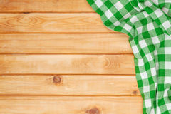 Green towel over wooden kitchen table Royalty Free Stock Images