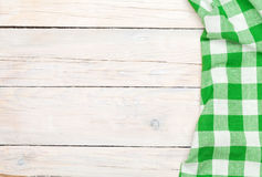 Green towel over wooden kitchen table Royalty Free Stock Photography