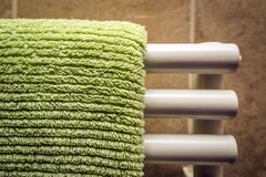 Green towel on radiator Stock Images