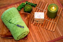 Green Towel with Soap and Candle in a Spa Stock Image