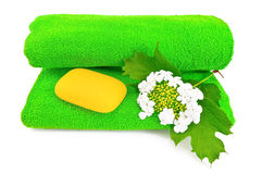 Green towel with soap and snowball Royalty Free Stock Photos