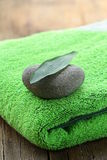 Green towel, stone and leaf Stock Photography