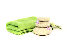 Green towel and stones Royalty Free Stock Images