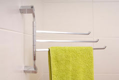 Green towel is on towel rail. Stock Photography