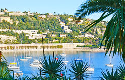 The green town of French Riviera. Vacation in lovely resort of French Riviera - Villefranche-sur-Mer, famous for the deepest natural Darse harbor, surrounded by Stock Image