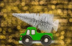 Fast wood car with fir tree in front of blurred lights stock photo