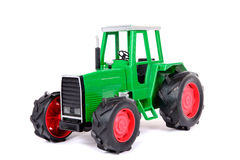 Green toy farm tractor Stock Images